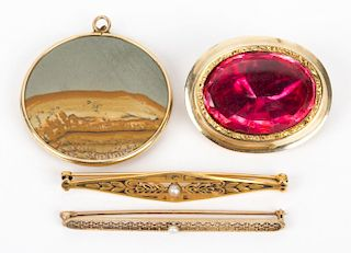 A Collection of Gold Pendants and Pins