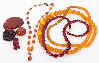 A Bag Of Amber Jewelry and Carvings