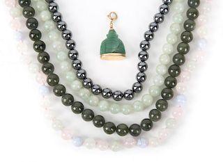 Jade and Hematite Beads along with a Jade Buddha