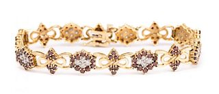 A Gold Red and White Diamond Bracelet