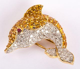 """A Yellow Sapphire and Diamond """"Dolphin"""" Brooch"""