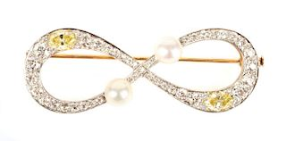 A White and Yellow Diamond Infinity Brooch
