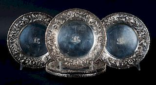 """Eight Kirk """"Repousse"""" bread & butter plates"""