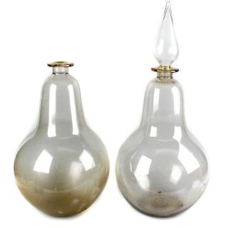 Two large blown glass apothecary or carboy display bottles, each of bulbous form, one with spire for