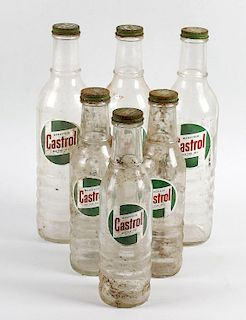 A collection of 21 assorted Castrol motor oil glass bottles. Comprising seven large (XXL, XL and Cas