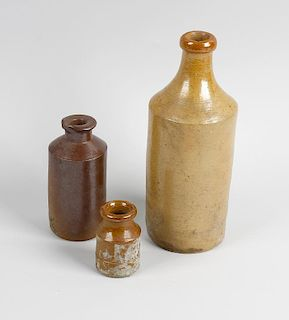 Two boxes containing a large collection of assorted stoneware bottles and jars To include brown ston