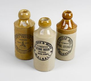 Two boxes containing a large collection of assorted pottery bottles Comprising a box of printed ston