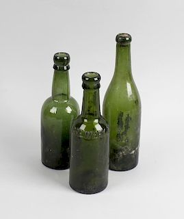 Two boxes containing a large collection of assorted glass bottles To include green glass beer and ut