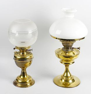 Two converted brass lamps. Each with glass shade, largest 21.5 (54.5 cm) high. (Requires re-wiring).