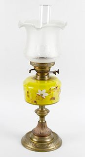 Two brass paraffin lamps, circa 1900, the first with frosted bell shaped shade over duplex burner, p
