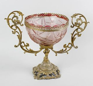 A coloured glass mounted centrepiece. The pink cut glass bowl having a lobed rim with plain and text