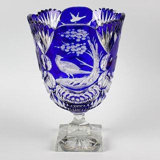 A heavy cut glass vase, the flash cut, blue overlaid glass bowl with frilled collar and bird decorat