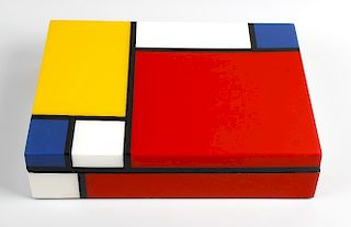 A Mondrian trust lacquered desk box. The rectangular cover decorated in bold geometric design in the