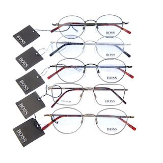 HUGO BOSS - five pairs of glasses. Four of the same design, differing in colour, featuring thin meta