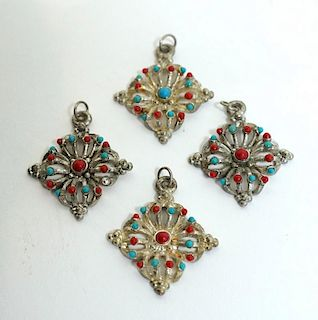 Four Metal Pendants With Blue And Red Beads