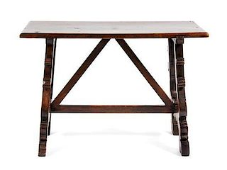 A Spanish Baroque Style Walnut Trestle Table Height 31 1/2 x width 45 1/2 x depth 22 1/2 inches.