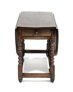 An English Oak Gate Leg Table Height 29 1/2 x width 52 x depth 21 inches (closed).