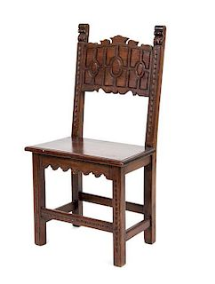 A Jacobean Style Walnut Hall Chair Height 39 1/2 inches.