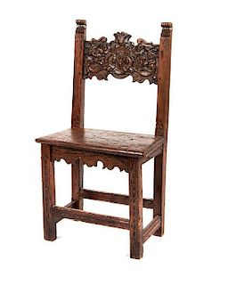 A Spanish Baroque Walnut Hall Chair Height 37 inches.
