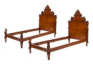 A Pair of Venetian Style Walnut Twin Beds Height 58 x width 39 x depth 73 inches.