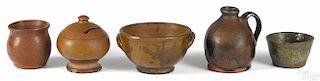 Five Pennsylvania redware articles 19th c., to include a bank, a sugar bowl, a miniature jug