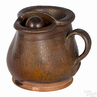 Redware shaving mug, 19th c., probably Pennsylvania, with speckled manganese decoration, 4 1/4'' h.