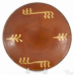 Pennsylvania redware pie plate, 19th c., with yellow slip decoration, 9 1/4'' dia.