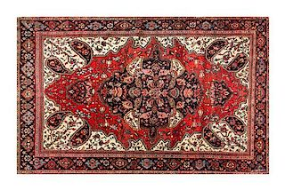 A Farahan Sarouk 6 feet 4 inches x 4 feet 2 inches.