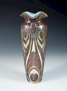 An Art Nouveau style iridescent glass vase with silver overlay, the slender form with flared rim, un