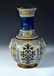 A Doulton Lambeth stoneware vase by George H. Tabor, the bottle form with incised and applied decora