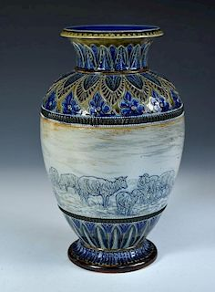 A Doulton Lambeth stoneware vase by Hannah Barlow, the baluster form incised with a frieze of sheep,