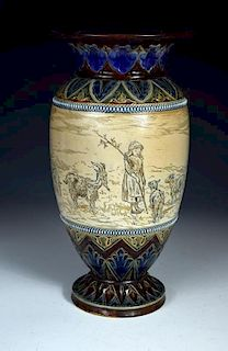 A Doulton Lambeth stoneware vase by Hannah Barlow, the baluster form incised with a young girl, goat
