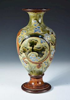 A Royal Doulton stoneware vase by Mark V. Marshall, the baluster form decorated with scrolling folia