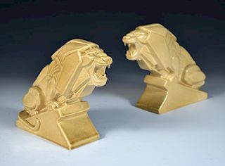 Percy Metcalfe, (British, 1895-1970) for Ashstead Pottery, a pair 'Lion of Industry' earthenware fig