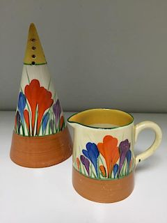 A Clarice Cliff Crocus pattern conical sifter, painted in colours with printed marks, together with