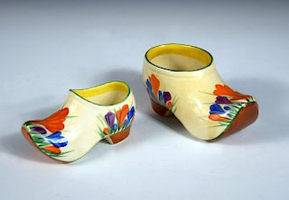 Two Clarice Cliff crocus pattern clogs, each painted in colours, printed marks, the larger 13cm long