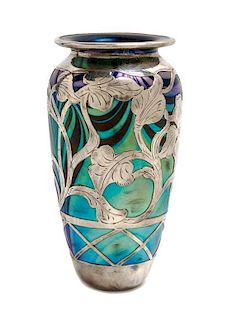 * A Loetz Glass and Silver Phanomen Genre Overlay Vase, Height 7 3/4 inches.