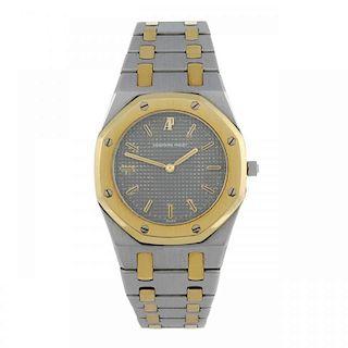 AUDEMARS PIGUET - a lady's Royal Oak bracelet watch. Stainless steel case with yellow metal bezel. N