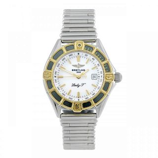 BREITLING - a lady's J-Class bracelet watch. Stainless steel case with yellow metal calibrated bezel