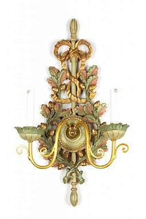 An Italian Carved and Painted Giltwood Two-Light Wall Sconce Height 25 inches.