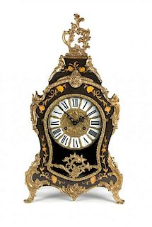 A German Louis XV Style Gilt Metal Mounted Marquetry Shelf Clock Height 22 1/4 inches.