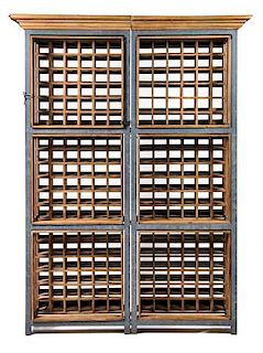 A Pair of Zinc and Mahogany Wine Storage Racks Height 85 x width 27 1/2 x depth 13 inches.