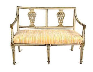 A Gustavian Painted and Parcel Gilt Settee Height 33 1/2 x width 42 x depth 21 1/2 inches.