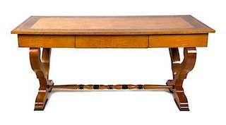 A Biedermeier Birch and Burlwood Writing Table Height 29 3/4 x width 66 x depth 29 1/2 inches.