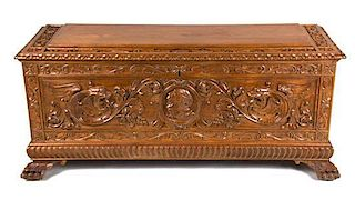 A Continental Carved Walnut Blanket Chest Height 21 1/2 x width 47 3/4 x depth 17 inches.