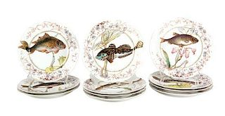 Eleven Limoges Porcelain Fish Plates Diameter 9 1/8 inches.