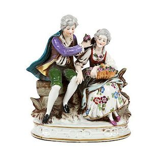 A German Sitzendorf Porcelain Figural Group Height 7 1/2 inches.