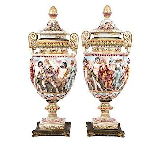 A Pair of Capo-di-Monte Porcelain Covered Urns Height 16 3/4 inches.