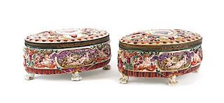 A Pair of Capo-di-Monte Porcelain Oval Boxes Length 10 inches.