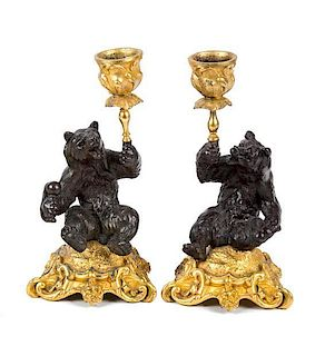 A Pair of Gilt and Patinated Bronze Figural Candlesticks Height 6 1/2 inches.